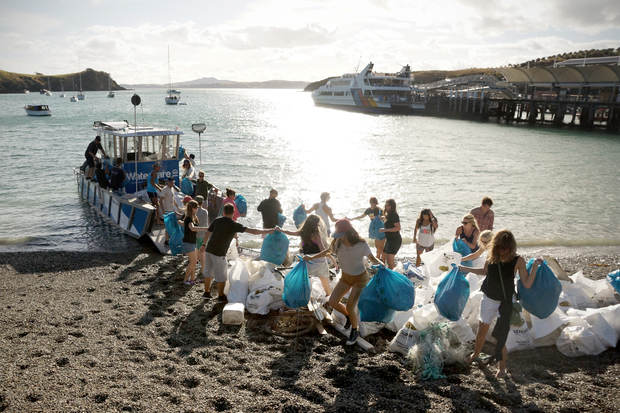 Captain Hayden Smith and a team of volunteers unload bags of rubbish collected in the Waitemata Harbour.