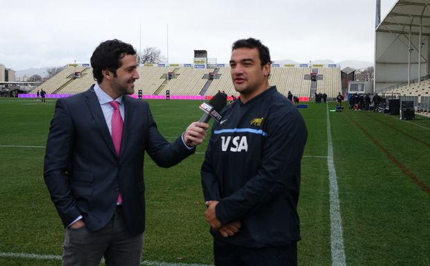Argentina captain Agustin Creevy talks to a reporter
