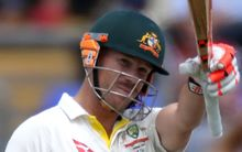 The Australia batsman David Warner celebrates his half century.