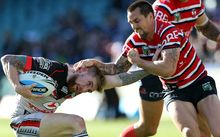 The Warriors' fullback Sam Tomkins is trapped by the Rooster Sam Maloney, 2015.