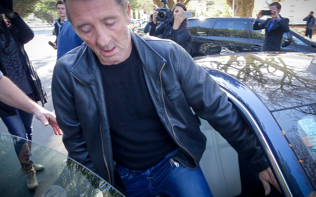 Phil Rudd gets into a Jaguar and drives away from Tauranga District Court.