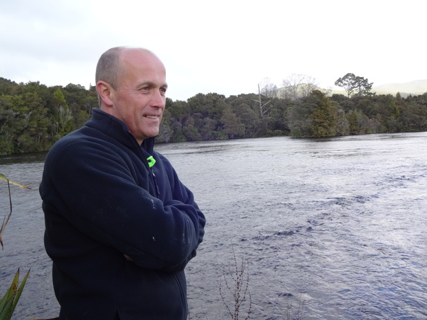 NZ King Salmon's freshwater manager Jon Bailey overlooking Te Waikoropupu Springs, from which the salmon hatchery draws its clear and cold water.