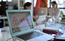 Logo of online home rental website Airbnb displayed on a computer screen in the Airbnb offices in Paris.