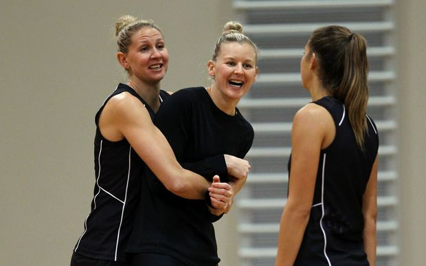 Silver Ferns captain Casey Kopua (L) hugs fellow New Zealand defender Katrina Grant