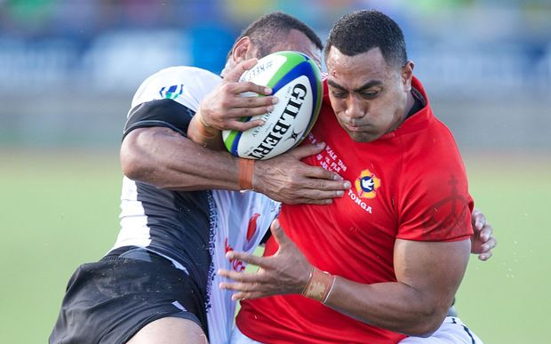 Tonga midfielder Sione Piukala in action against Fiji.