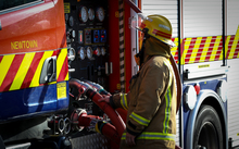 Fire fighter checking the pressures of the appliance at 242 Adelaide Road, Newtown.