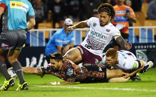 Shaun Johnson injures his ankle as he scores against Manly