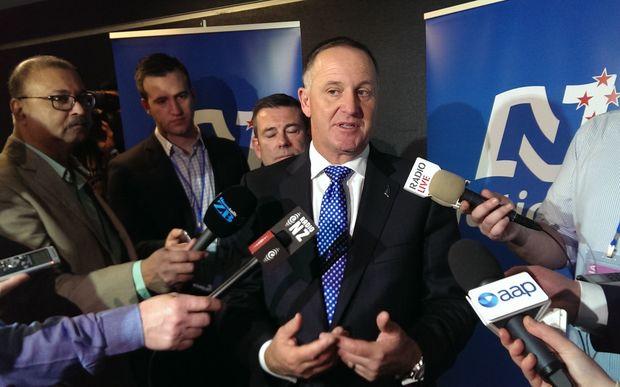 John Key talking to media after his leader's speech.
