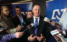 John Key talking to media after his leader's speech.
