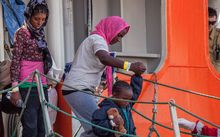 Women and children are among the scores of migrants arriving in Sicily after attempting to cross the Mediterranean Sea.