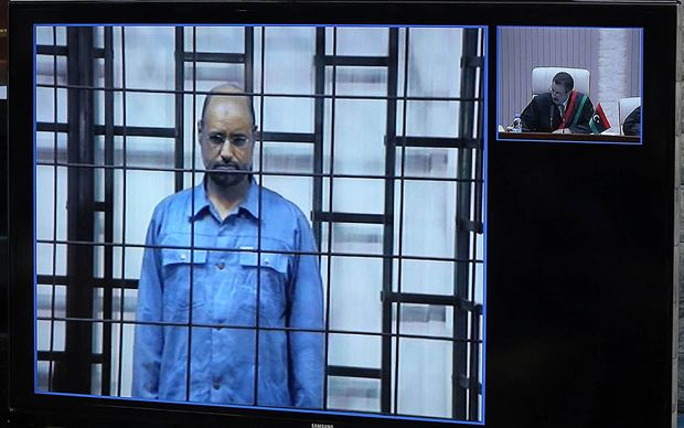 Saif Al-Islam Gaddafi during his trial, with the judge to the right.