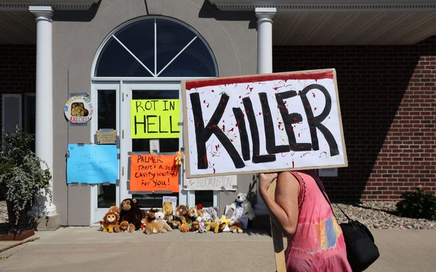 Protesters gathered outside Dr  Walter Palmer's clinic in Bloomington, Minnesota.