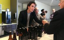 Moa founder Josh Scott serves beer to investors at the company's annual meeting in Auckland.