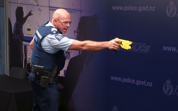 Sergeant Darrin Putt demonstrates the use of a taser.