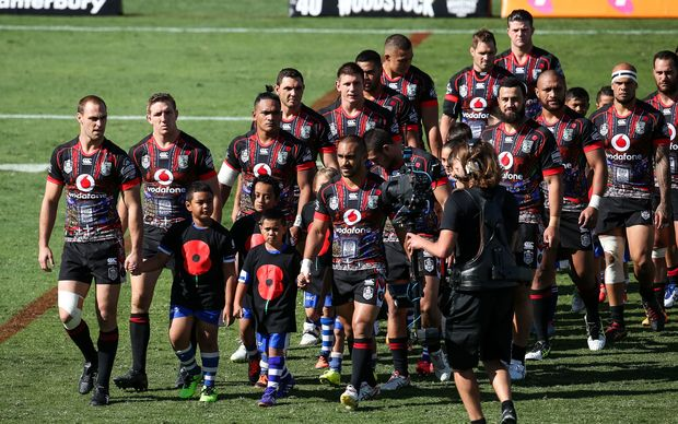 Captain Simon Mannering (L) leads the Warriors out onto Mt Smart Stadium on ANZAC Day against the Gold Coast  Titans, on Saturday 25 April 2015