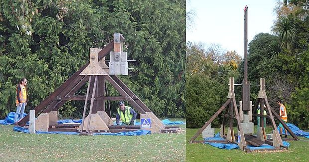 The trebuchet, a 4-metre high medieval siege catapult, is in a cocked position ready to fire (left) and (right) the arm is extended vertically after it has fired and flung the ballistic.