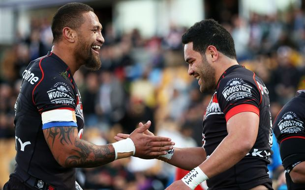 Manu Vatuvei (L) celebrates his assist for Warriors team-mate Konrad Hurrell's try vs Cronulla Sharks at Mt Smart Stadium, Auckland, New Zealand 1 August 2015