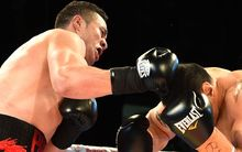 New Zealand heavyweight Joseph Parker knocks out Australian Bowie Tupou in the first round of their fight.