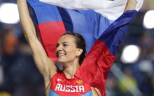 Pole vaulter Yelena Isinbayeva of Russia celebrates after winning. Note: she is not implicated in the latest doping claims.