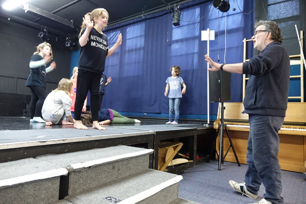 Theatre director Mike Friend taking students through their paces.