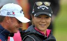 The New Zealand golfer Lydia Ko shares a joke with her caddy at the British Open.