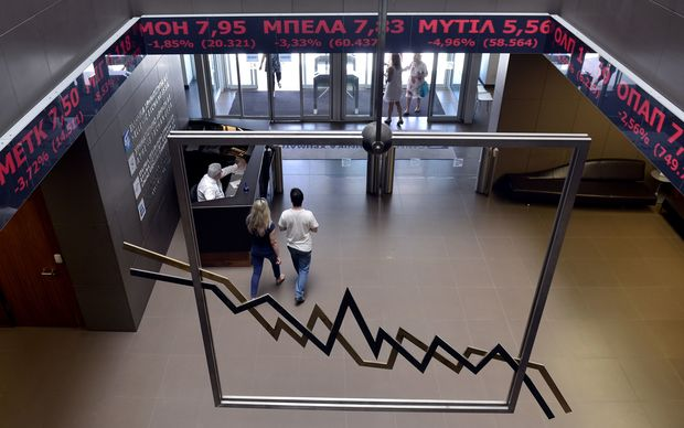June 15, 2015: people walk through the Athens Stock Exchange lobby. Greece's main stock exchange in Athens will reopen on August 3, 2015 after being closed for five weeks by the debt crisis