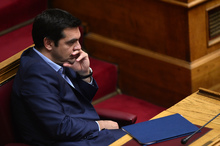 Greek Prime Minister Alexis Tsipras listens to speakers in Parliament on 23 July 2015.