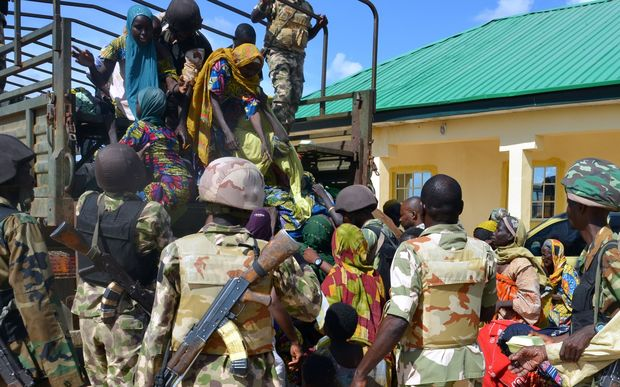Soldiers assist people rescued from Boko Haram camps in Maiduguri, Borno State, on July 30, 2015. AFP PHOTO / STRINGER