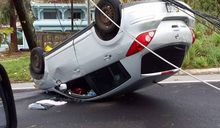 Car in Saipan left upside down by Typhoon Soudelor