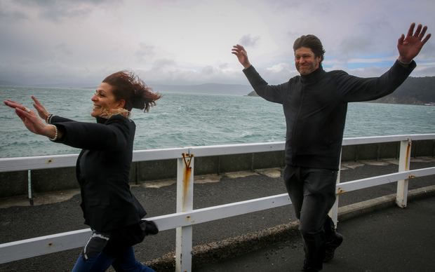 Jenny and Johan Grobler of Auckland embracing the wild wind of Wellington at Greta Point.