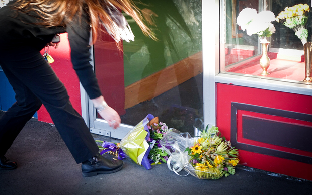 A Waimate resident paying tribute to the  Kafle family outside their restaurant, Everest Indian Restaurant.