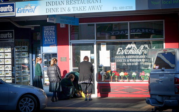 Waimate residents paying tribute to the Kafle family outside their restaurant.