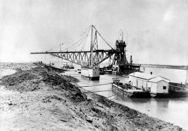 A picture from 1869 shows machinery during the construction of the Suez Canal in Egypt.