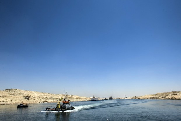 A picture taken on July 29, 2015 shows boats crossing the new waterway at the new Suez Canal in the Egyptian port city of Ismailia, east of Cairo.