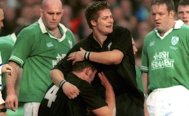 Richie McCaw congratulates Chris Jack after scoring a try against Ireland in 2001. The match was McCaw's test debut.