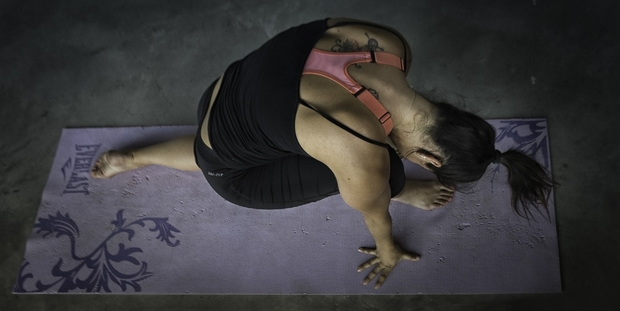 A woman doing yoga.