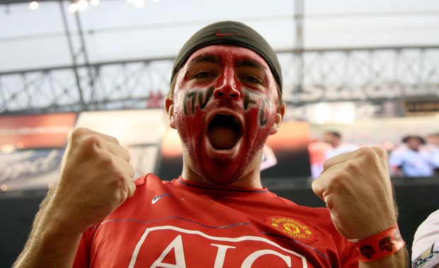 A Manchester United fan celebrates during the game of the MLS All-Stars against Manchester United FC in the 2010 MLS All-Star game in Houston, Texas.