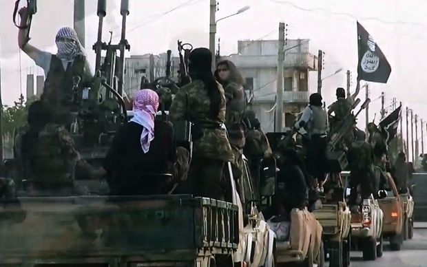 An image from an Islamic State video released in March 2014 shows fighters in the Syrian city of Homs.