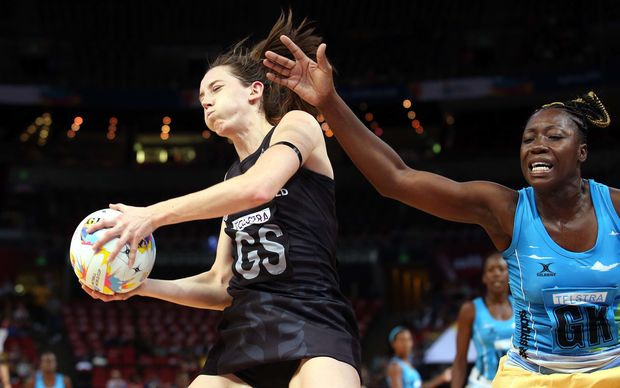 Silver Ferns shooter Bailey Mes catches the ball as Barbados goalkeeper Shonette Bruce tries for the intercept at Allphones Arena, Sydney, August 7th 2015