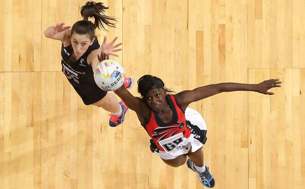 Bailey Mes of New Zealand and Kielle Connolly of Trinidad & Tobago compete for the ball.