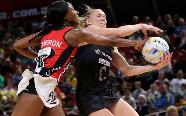 aura Langman of New Zealand is challenged by Amanda Cameron of Trinidad & Tobago.