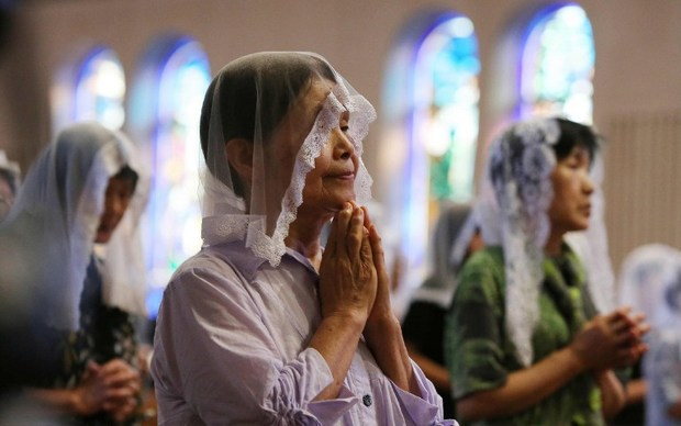 People attend a morning mass for victims of the World War II atomic bombing of Nagasaki at the city's Urakami cathedral.