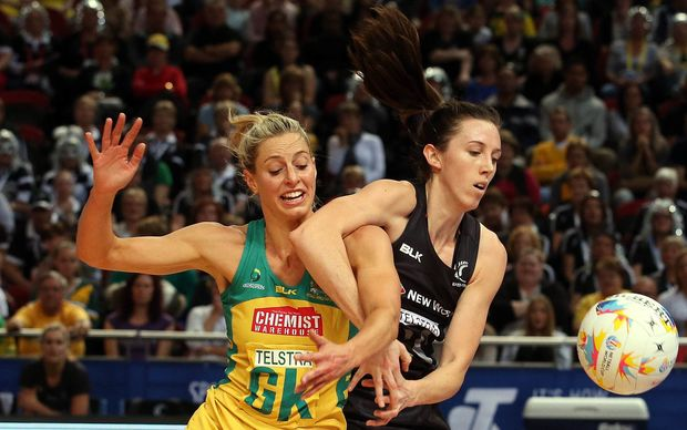 The Silver Ferns Bailey Mes takes the ball from Laura Geitz 2015.