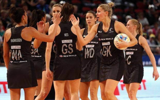 The Silver Ferns enjoy a modest celebration following their World Cup pool game win over Australia, 2015.