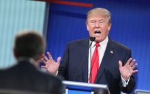 CLEVELAND, OH - AUGUST 06:  Republican presidential candidate Donald Trump fields a question during the first Republican presidential debate hosted by Fox News and Facebook at the Quicken Loans Arena on August 6, 2015 in Cleveland, Ohio. 