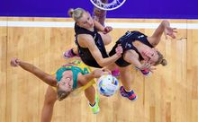 Silver Ferns defenders Casey Grant (left) and Casey Kopua battle it out with Australia shooter Caitlin Bassett.