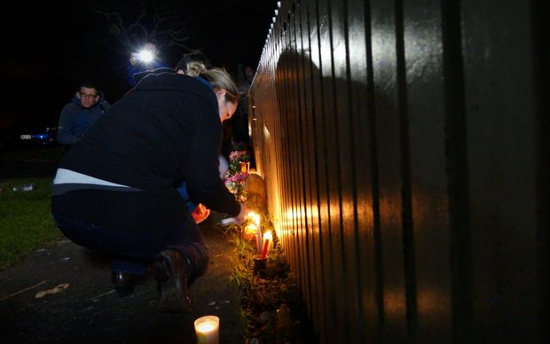 Neighbours and friends lit candles at the Onehunga home.