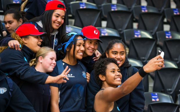 Fiji's Episake Kahatoka takes a photo with fans at the Netball World Cup.