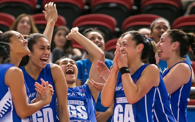 Samoan players share a laugh at the Netball World Cup.