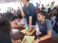 Saipan residents queue for post-typhoon aid at the American Memorial Park, Northern Marianas.